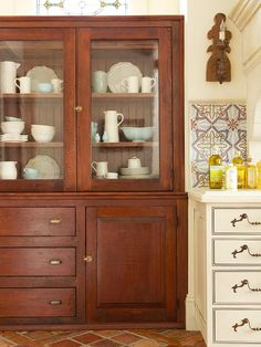 Love this cabinet. It looks like they found an antique piece of furniture and built the space around it.