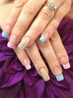 Nail Art Photo Taken at:27/08/2013 16:12:13 Nail Art Photo Uploaded at:29/08/2013 18:58:47 Nail Technician:Elaine Moore Description: Nude, pink and blue polish with Swarovski crystals  @ www.eyecandynails.co.uk