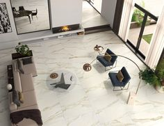 Want to upgrade your living room? Our marble look Milan 24x48 Polished Porcelain Tile in Calacatta Oro is just the thing you need for your modern living room remodel! Besides being absolutely stunning, it is also more durable than real marble!