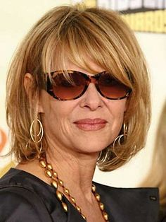 Short layered bob hairstyles with light brown hair color and bangs for women over 50 look beautiful with glasses