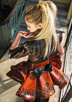 Ornate black applique on orange latex dress with ruffle sleeved top.  Find latex material for fashion at: www.MJTrends.com