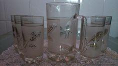 Juego de vaso con jarra.