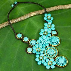 Calcite beaded necklace, 'Floral Sunlight' - Beaded Necklace with Turquoise Color Flowers and Suns