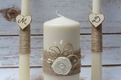 Ivory Rustic Unity Candle set for your ceremony Set of 3 candles decorated with natural burlap and the wooden hearts have been engraved with a wood burner. The Big Unity is decorated with linen rose flower ,pearls and twine rope. Color : Ivory Please note that you can choose