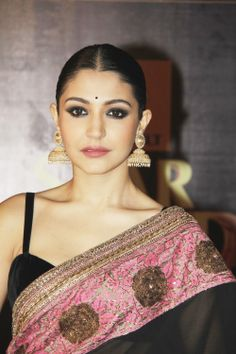 Anusha rocking heavy jhumkas at an award ceremony