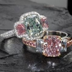 The two diamond rings: one with a 2.60 ct. natural green diamond valued at one million, and another with a pink diamond from Angola valued at seven hundred thousand. - Clodius & Co. Jewelers in Rockford, Ill.