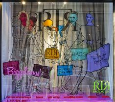 Quirky illustrated window display for a packaging company in NYC