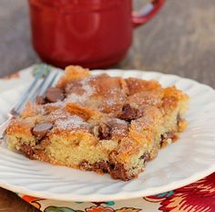 Chocolate Chip Sour Cream Cake is soft, moist and tender. Cinnamon sugar and milk chocolate chips are inside and on top of this delicious cake!