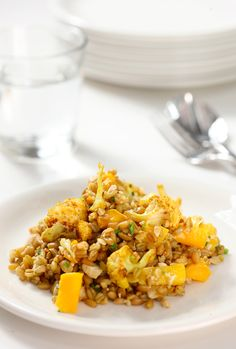 Curried Freekah with Cauliflower, Mango & Cashews. Ingredients: Mulberry & Vine+ 2 cup cooked whole grain freekah + 1 tablespoon peanut oil + 1/2 small head cauliflower, cut into small florets (about 2 cups) + 1 tablespoon curry powder + 1 teaspoon salt + 1/2 cup raw cashews, chopped and toasted + 1 medium mango, peeled and diced fine + 2 tablespoons minced fresh chives + 1/4 teaspoon ground black pepper