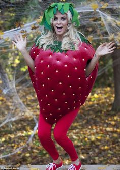 Jenny McCarthy slipped herself into a voluminous strawberry costume for a Halloween carnival