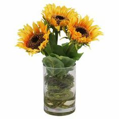 "Silk sunflowers in a clear glass vase.  Product: Faux floral arrangementConstruction Material: Silk, plastic, acrylic and glassColor: Yellow, brown and greenFeatures: Suitable for indoor use onlyIncludes faux sunflowersDimensions: 13"" H x 11"" Diameter"