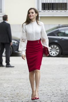 Queen Letizia of Spain, wearing a red pencil dress and a gorgeous white blouse