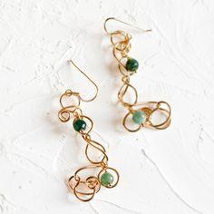 Green agate swirl earrings, in 18K gold plated and vitrified brass wire.  Earwire fastening in 18K gold plated and vitrified sterling silver.