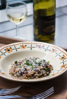 A delicious take on risotto with farro (cracked wheat), flavorful radicchio, and bacon. A great first or main course, or a hearty side dish too!
