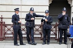 Police officers taking a tea break during the Royal Wedding  London