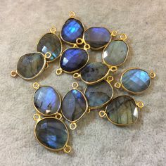 ☛ PRODUCT DETAILS ☚ Material: Labradorite Style: Bezel Connector (Two Suspension Rings) Color: Iridescent Blue with Gold Bezel Edging* (Randomly