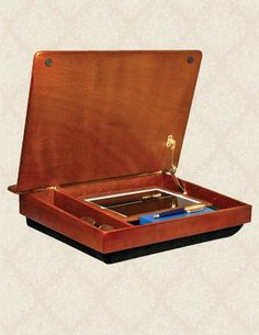 PORTABLE WOODEN LAP DESK WITH COMFORTABLE CUSHION AND INTERIOR STORAGE VT,http://www.amazon.com/dp/B00BQUXZUU/ref=cm_sw_r_pi_dp_WZASsb099W0EEH6S