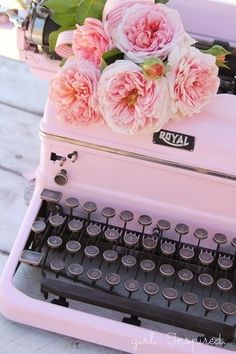 Pink vintage typewriter and flowers