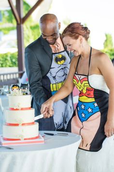 Any couple that wears super hero aprons while they cut their cake knows how to have a good time.