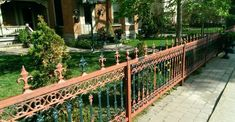 An old iron fence in need of repainting adds to the character.
