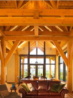 Beautiful wood timbers. Look how the light fills the space. Warm and cozy! #vertical-arts.com