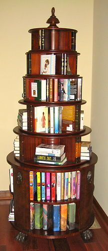 Round, spinning bookshelf by Thomasville. Let this unique, functional piece speak for itself!