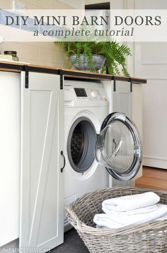 We could take our washer and dryer off their pedestal, cover with countertops that match the rest of the kitchen (so I have a space for folding clothes), relocate our popup ironing board somewhere easier, and add some darling mini barn d Diy Barn Door, Sliding Barn Door Hardware, Diy Door, Barn Doors, Sliding Doors, Door Latches, Door Hinges, Hidden Laundry, Small Laundry