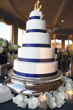 A five-layer cake decorated with navy blue satin ribbon and topped with two brass anchors sweetened the occasion. Unique flavors represented almost every layer; chocolate fudge cake with bittersweet ganache and fresh caramel on one; brown butter almond cake with toasted pecan caramel on another; white chocolate mousse and fresh strawberries made up the second and third layers and finally, just for the bride, a vegan, gluten-free chocolate cake topper with vegan buttercream and raspberry preserve