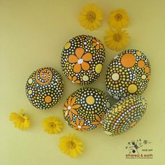 FREE SHIPPING!  Hand Painted River Rocks - yellow shades of orange collection (5) piece set (1) 3 X 2.5 .75 (1) 2.75 X 2.25 X .75 (1) 2.75 X 2.75 X .75 (1) 2.75 X 2.25 X.5 (1) 2.25 X 2 X .50 - Total Weight - 28 ounces  Natural Home Decor - One-of-a-Kind Accents - Mandala Inspired Design Rock Art - Garden Art - Weather Resistant Lacquer Finish  As in nature no two ethereal & earth stones are alike. Each stone and its design is unique. I work with each stones shape, size, and texture to create…