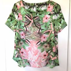 Hawaiian Print Blouse Ooooww I love this! Beautiful sides. It's too tight to model (arms). In perfect condition, only worn once. Button closure in the back.  100% polyester. Best for XS! Rose & Olive Tops Blouses