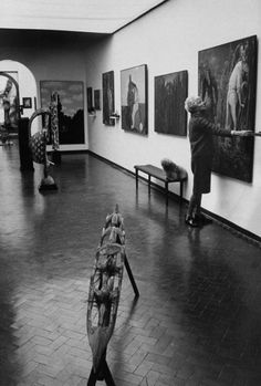 Peggy Guggenheim examining Max Ernst's The Antipope in her Venice Gallery. Photo: Carlo Bavagnoli, 1965