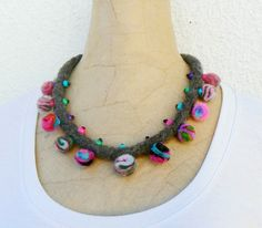 Ethnic necklace, Felt Pompons choker, Wearable textile art, Tribal style necklace, Bright colorful bib, Rustic short necklace. Felted necklace spiced up with some wood beads; it closes with a bronze clasp. The length can be adjusted using the chain that hangs from one extreme. This necklace was inspired in the north western Argentinean inhabitants, the coyas. Coyas women spin wool while they take care of their goats. With their wool they create, among other things, beautiful and bright…