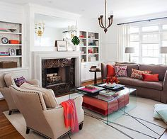 Light and Lovely living room - love the ottomans under the lucite tables!