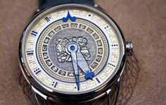"""The De Bethune DB25 Ninth Underworld. Each gold dial has been engraved by Michèle Rothen and depicts numerals of the Mayan numbering system, glyphs of divinities, animals and sacred objects representing days of the calendar. At its center sits the baktun, a period glyph that represents the """"Long Count"""" or 144,000 days (the end of which arrives this December)."""