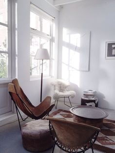 B&B Studio24/ Amsterdam / photo: Krista Keltanen - sitting area - Neutral colours - whites and browns - leather chair - pouf