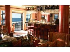 Nestled under Table Mountain's Twelve Apostles, and overlooking the water of Camps Bay, the Leopard Lounge has probably the finest sun-downer view in Table Mountain, Party Venues, Young Models, Mediterranean Style, Cape Town, Table Settings, Lounge, Real Estate, Bar
