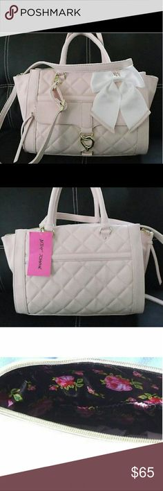"""Quilted satchel Betsey Johnson purse New with tags! Gorgeous powder pink Betsey johnson satchel  Top handle bag with adjustable crossbody strap  Black interior with roses  Roomy Can be worn 2 ways! With sides tucked in or out!  Originally $98!+tax  Beautiful heart clasp on the front opens to zippered compartment  Removable long crossbody strap included   Measures:   12"""" L x 5""""W x 9"""" H Strap drop is 6""""   Beautiful white bow charm detail on the front! Betsey Johnson Bags Satchels"""