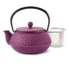 very sweet purple tea pot...  could curl up with a good book and a nice pot of tea ;)  @republicoftea.com