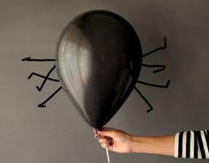 14 Scary Awesome DIY Halloween Balloons via Brit + Co.