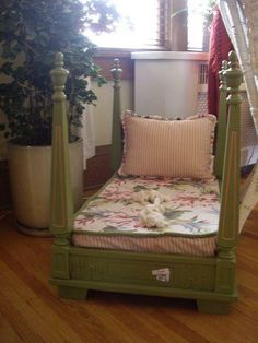 A Table turned upside down, a toddler mattress, and a pillow. A cheap miniature 4 poster bed! Cheap tables can be found in thrift stores or antique shops.  (From Old School Parenting on FB)