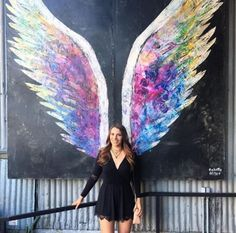 Colette Miller angel wings located at Angel City Beer in the DTLA Arts District