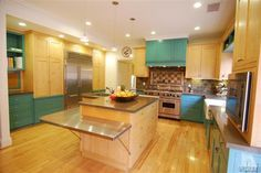 amazing kitchen---colors, island wrap around shelf for eating, space