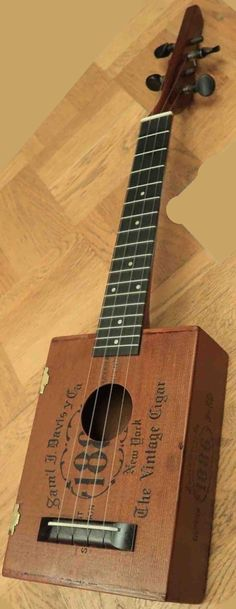 Possibly the most expensive cigar box instrument in the world?! It purports to be one that Sam Kamaka made in 1940; and it does look like one in the Magazine Lardys Ukulele of the day 2017 --- https://www.pinterest.com/lardyfatboy/