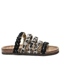 "To quote Zoolander, footbeds are ""so hot right now."" Rock this trend with a twist. Muk Luks' multi-strap style with leopard print and braiding details will give your feet a major makeover. We think these sandals would be great for grabbing a casual lunch with friends, walking the dog, hitting the beach or running errands,."
