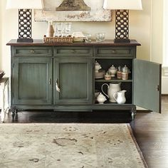 I would love to have a side board in my kitchen just like this instead of placing cabinets along one wall....  These add such character and charm to a country kitchen.  <3