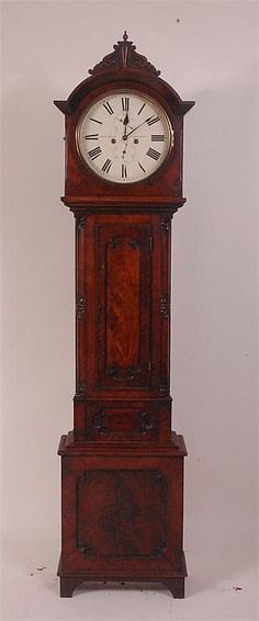 A circa 1830 mahogany longcase regulator, the painted circular dial signed John Hood of Cupar Fife, with subsidiary seconds dial and date dial, having four pillar eight day brass weight driven movement striking on a bell, with rod pendulum, the case having carved and panelled door within bowed canted corners, h.210cm