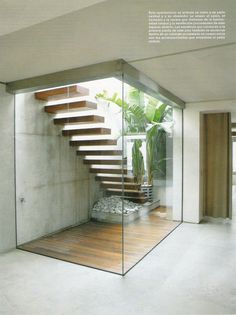 cantilevered steps, minimal glass frame and some planting. Would choose different materials though