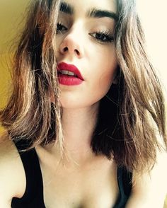 """"""" lilyjcollins :You don't need a holiday to rock a red lip… """""""