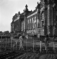Gardening amid ruins in front of the Reichstag, Berlin, 1945, by David Seymour