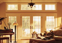 I would die if my living room looked like this. The french patio doors are amazing. I love the way the sun light comes in through them, and lights up the room. Maybe I can convince my husband to let us upgrade our living room a little. Sunroom Windows, Transom Windows, Windows And Doors, French Doors With Screens, French Doors Patio, French Patio, Hinged Patio Doors, Sliding Patio Doors, Door Design